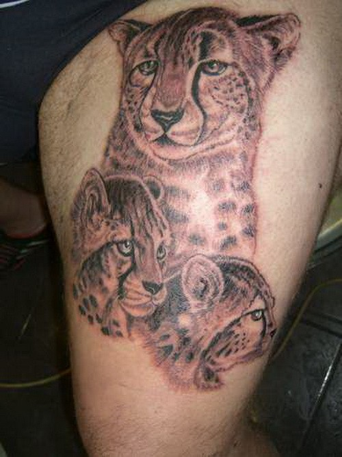 Cheetah mother with cubs tattoo on thigh