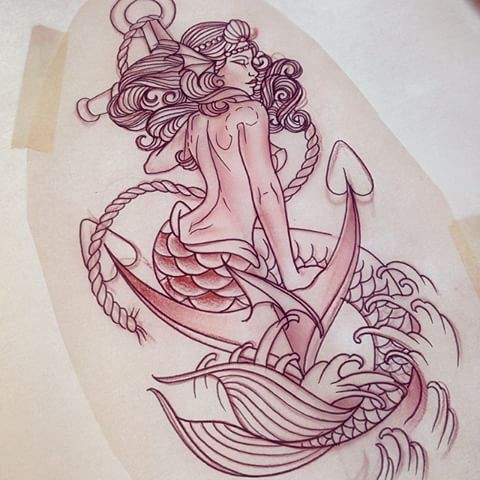 Classic uncolored mermaid sitting on anchor tattoo design