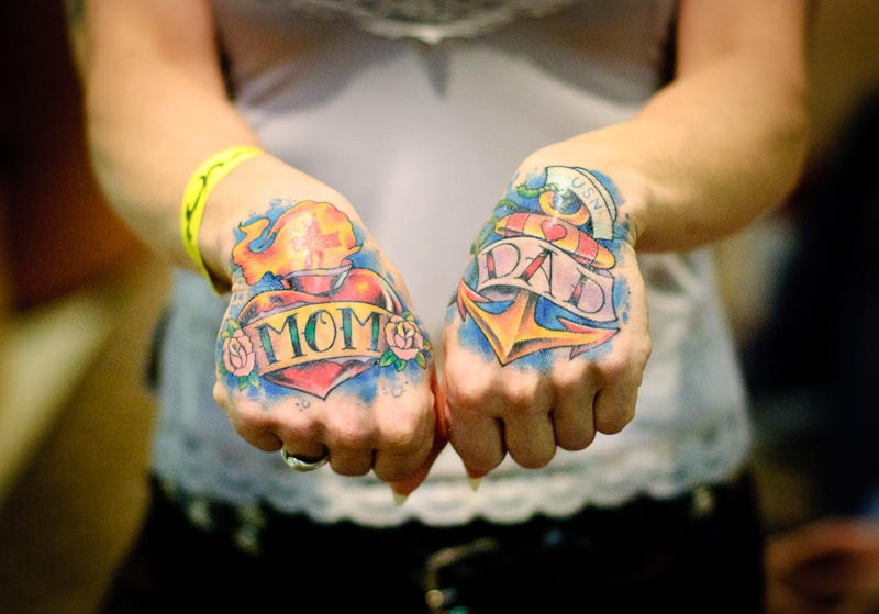 Colored old school ribbon anchor and heart with signs tattoo on hand