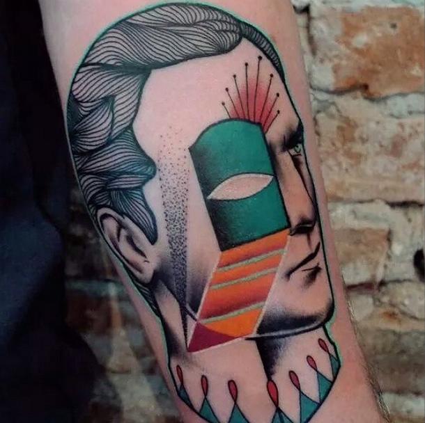 Colored by Mariusz Trubisz tattoo of man head