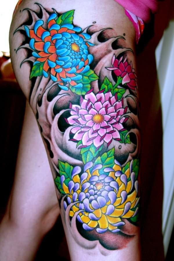Colored japanese flowers in black waves tattoo on thigh