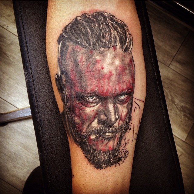 Colored portrait of viking tattoo on leg