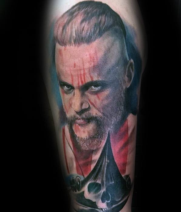 Colored portrait of viking with skull tattoo