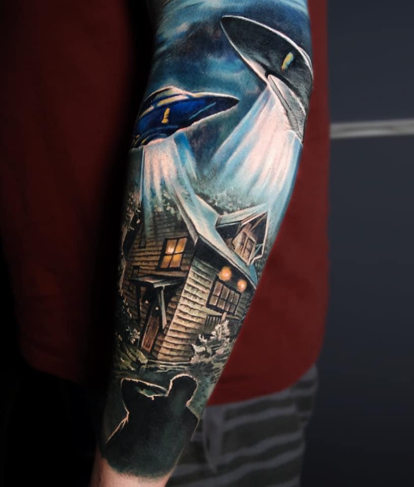 Colorful alien theme tattoo on forearm