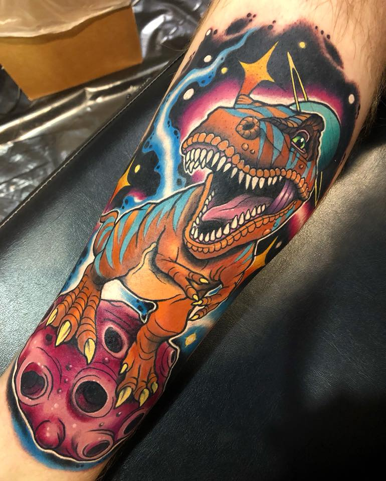 Colorful dinosaur in space tattoo