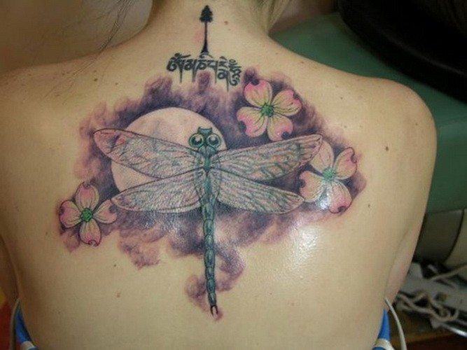 Colorful dogwood flowers and dragonfly tattoo on back