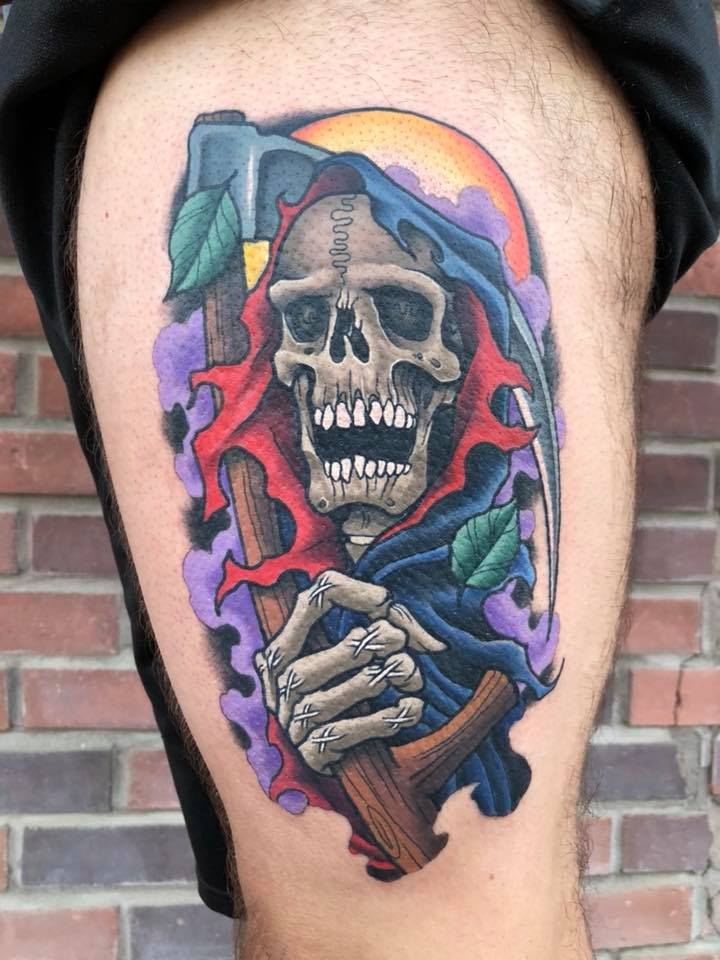 Colorful grim reaper tattoo on leg