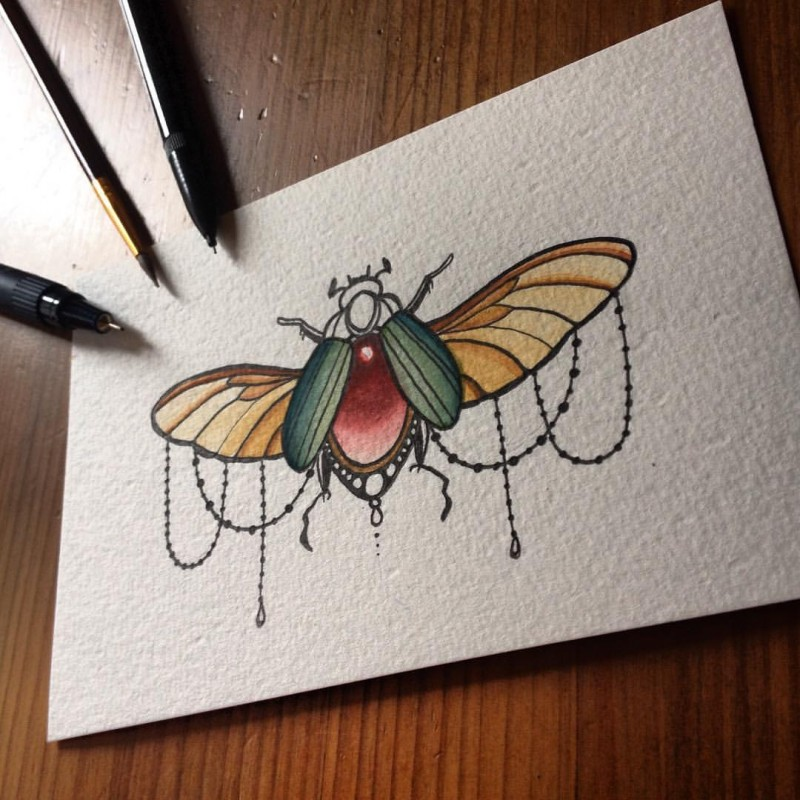 Colorful lace-decorated bug with gem-body tattoo design