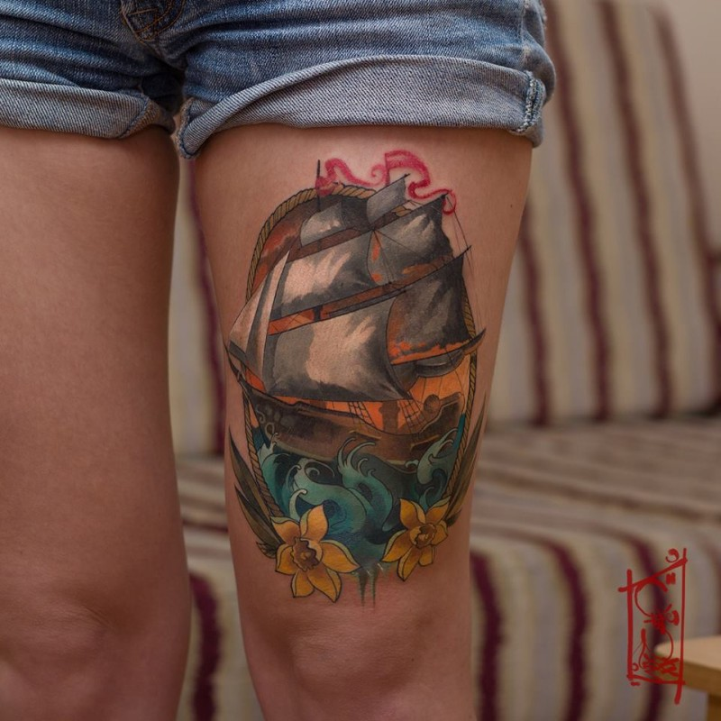 Colorful ship tattoo on leg