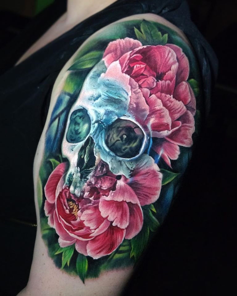 Colorful skull and peony tattoo on shoulder