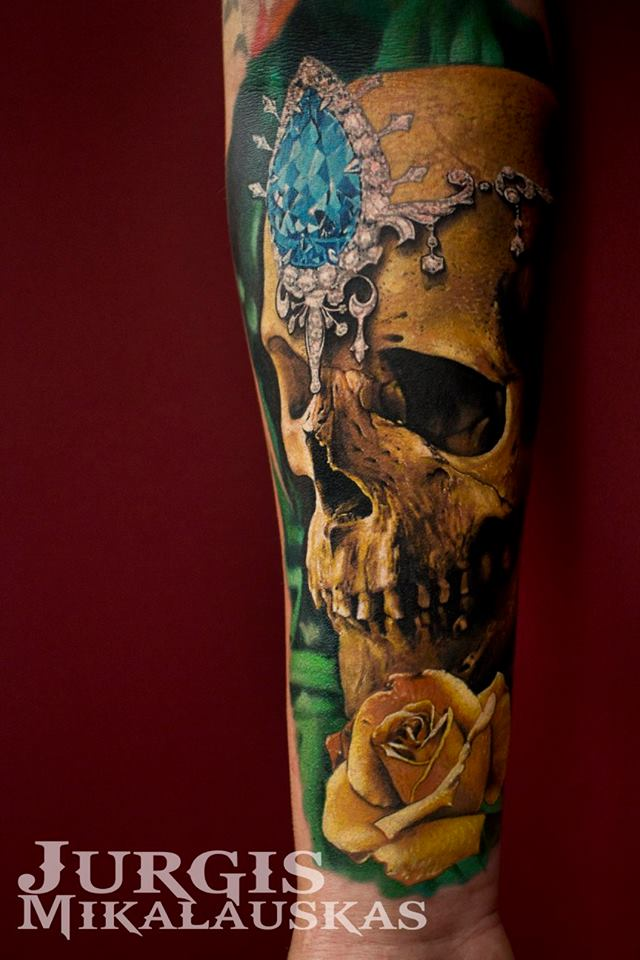 Colorful skull with diamand tattoo on arm