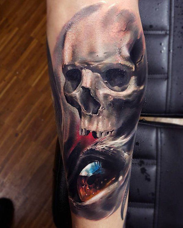 Colorful skull with eye tattoo by Wild Tattoo