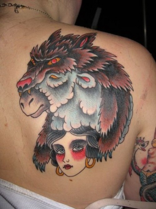 Colorful wolf in sheep skin and gipsy girl tattoo on back
