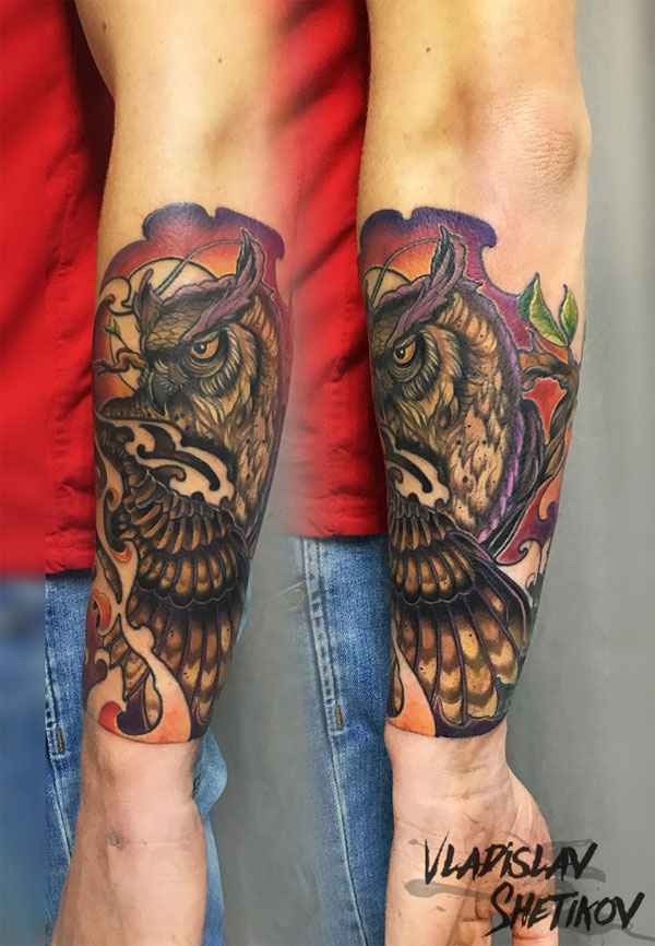 Colorfull owl tattoo on forearm