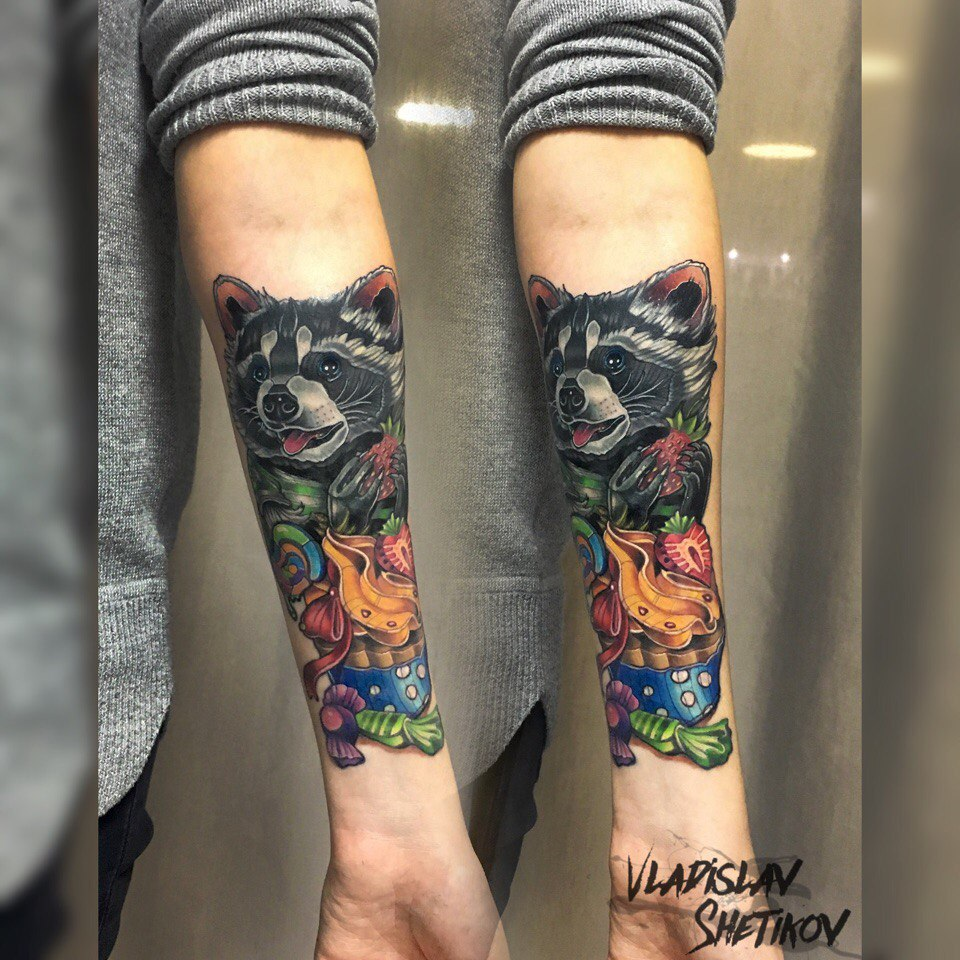Colorfull tattoo with raccoon and fruits