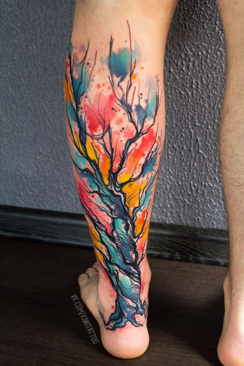 Colorfull watercolor tree  tattoo on leg