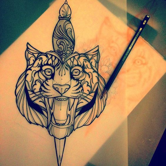 Confuced tiger head killed with a dagger tattoo design