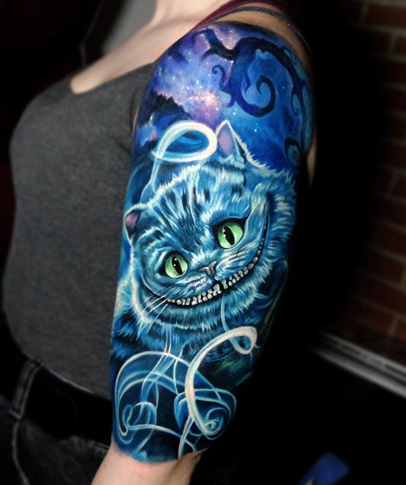 Cool Cheshire Cat in blue color tattoo