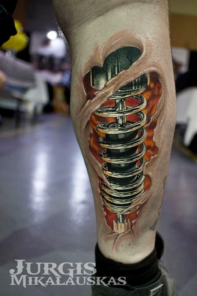 Cool biomechanical tattoo on leg