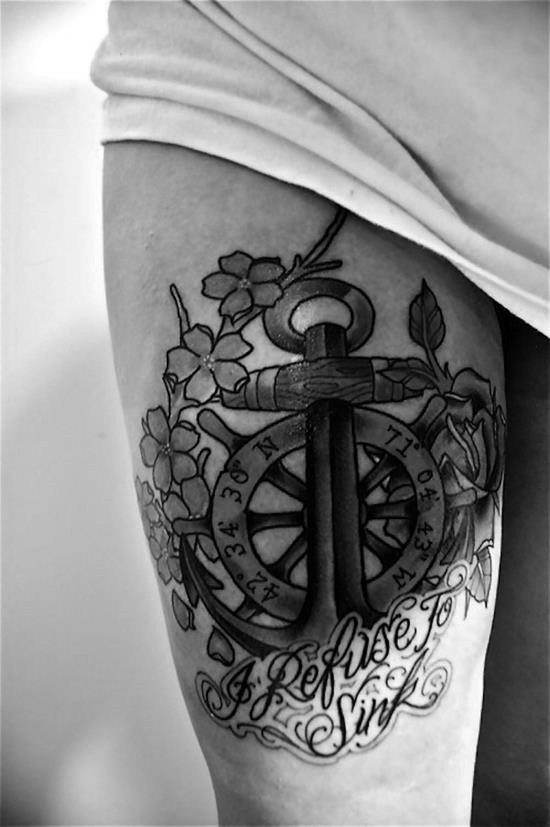 Cool black-and-white anchor with lettered wheel tattoo on thigh