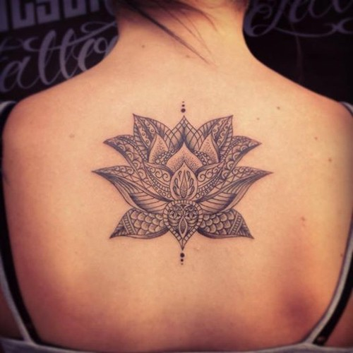 Cool black-ink tribal lotus flower tattoo on back