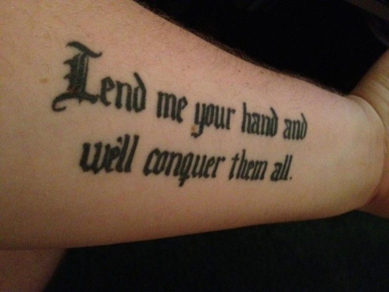 Cool black-lettered quote tattoo for men on forearm