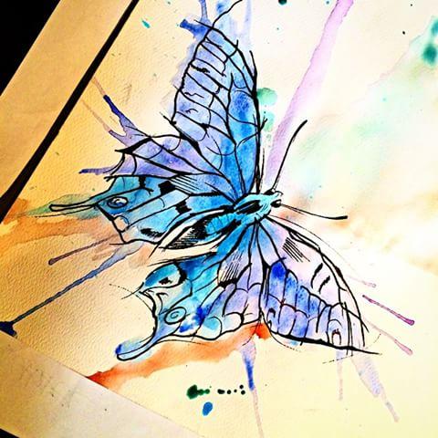 Cool black-line butterfly on blue watercolor splash tattoo design