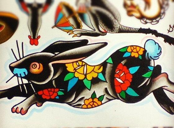 Cool black old school hare wirh bright floral print tattoo design