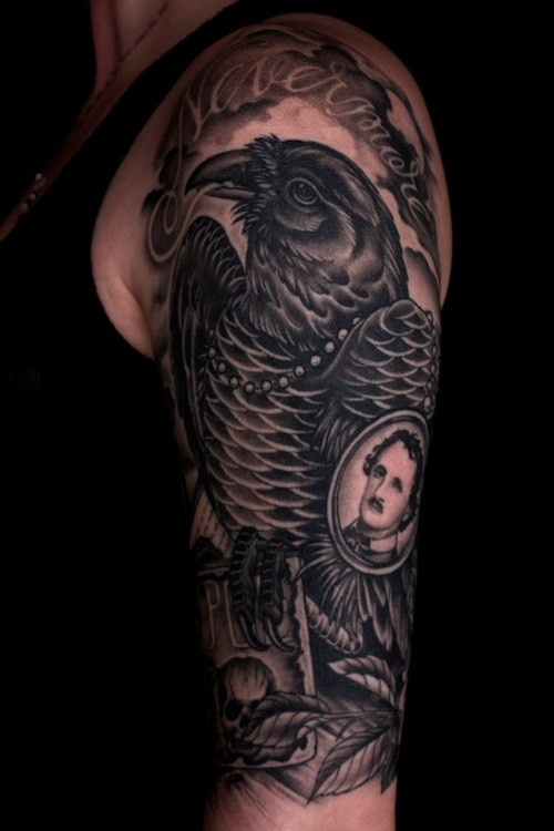 Cool black raven with edgar poe portrait tattoo on upper for Cool upper arm tattoos