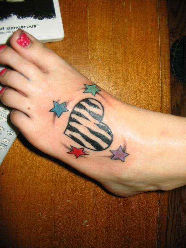 Cool colorful zebra heart and stars tattoo for girls on foot