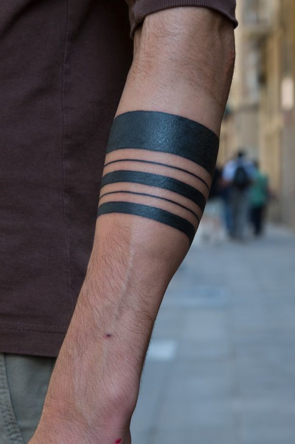 Cool Different Line Black Ink Tribal Band Tattoo On Forearm