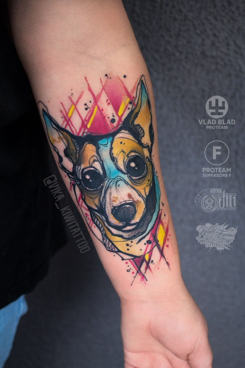 Cool dog tattoo on wrist