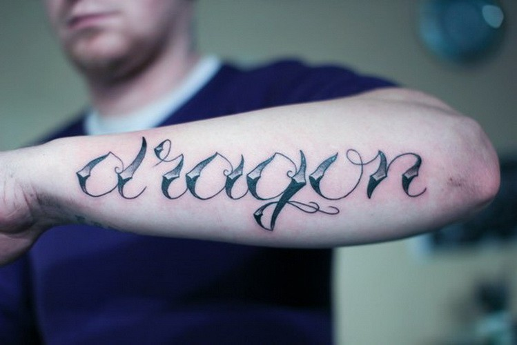 Cool dragon quote tattoo on arm