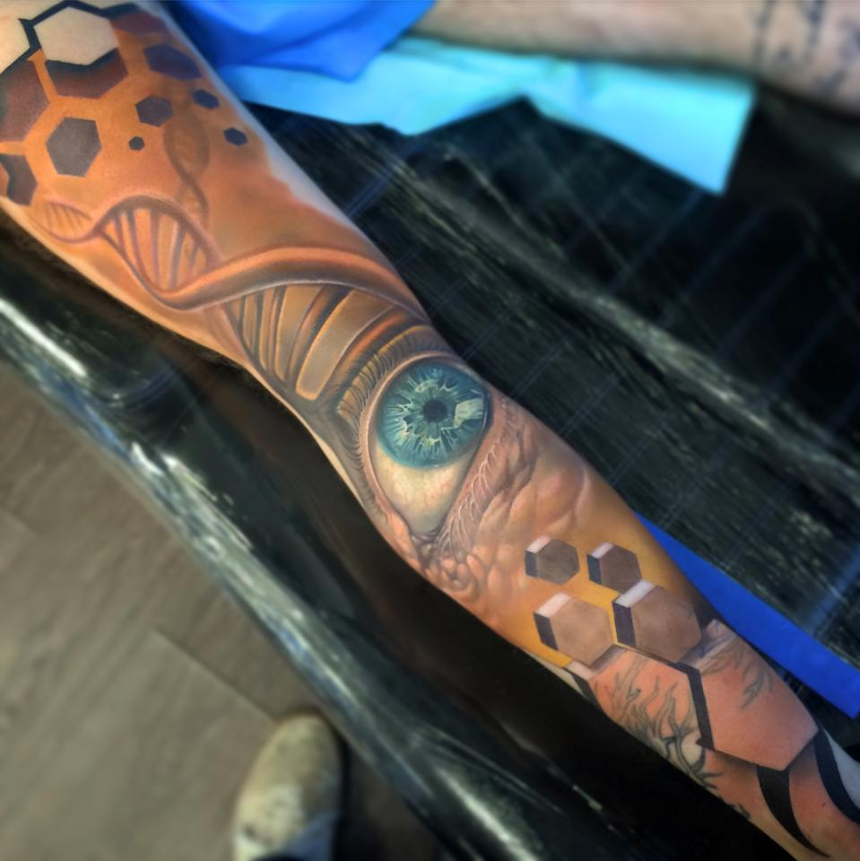 Cool full sleeve tattoo with eye and 3d hexagons