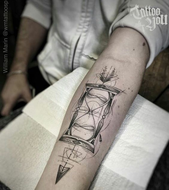 Cool geometric hourglass forearm tattoo