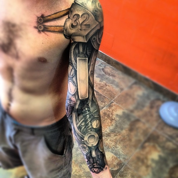 Cool iron robot arm tattoo with shoulder strap