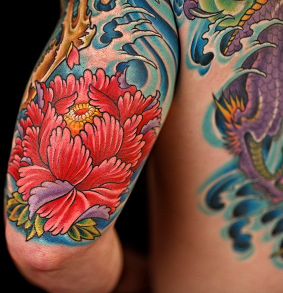 Cool Red Japanese Peony Flower In Waves Tattoo On Upper Arm