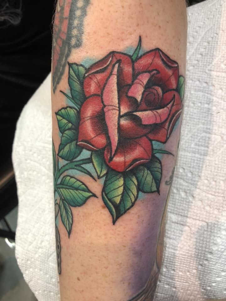 Cool rose tattoo on arm