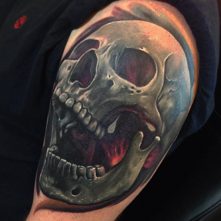 Cool skull tattoo on shoulder