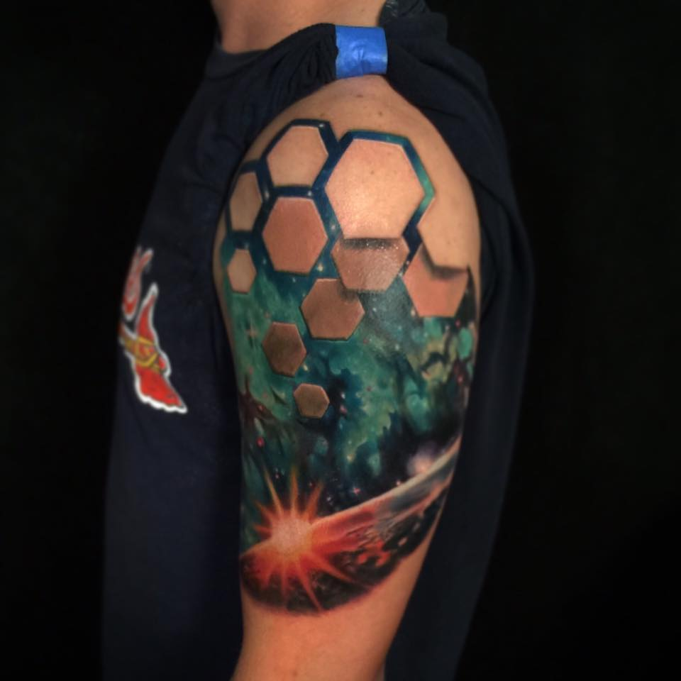 Cool space theme tattoo on shoulder