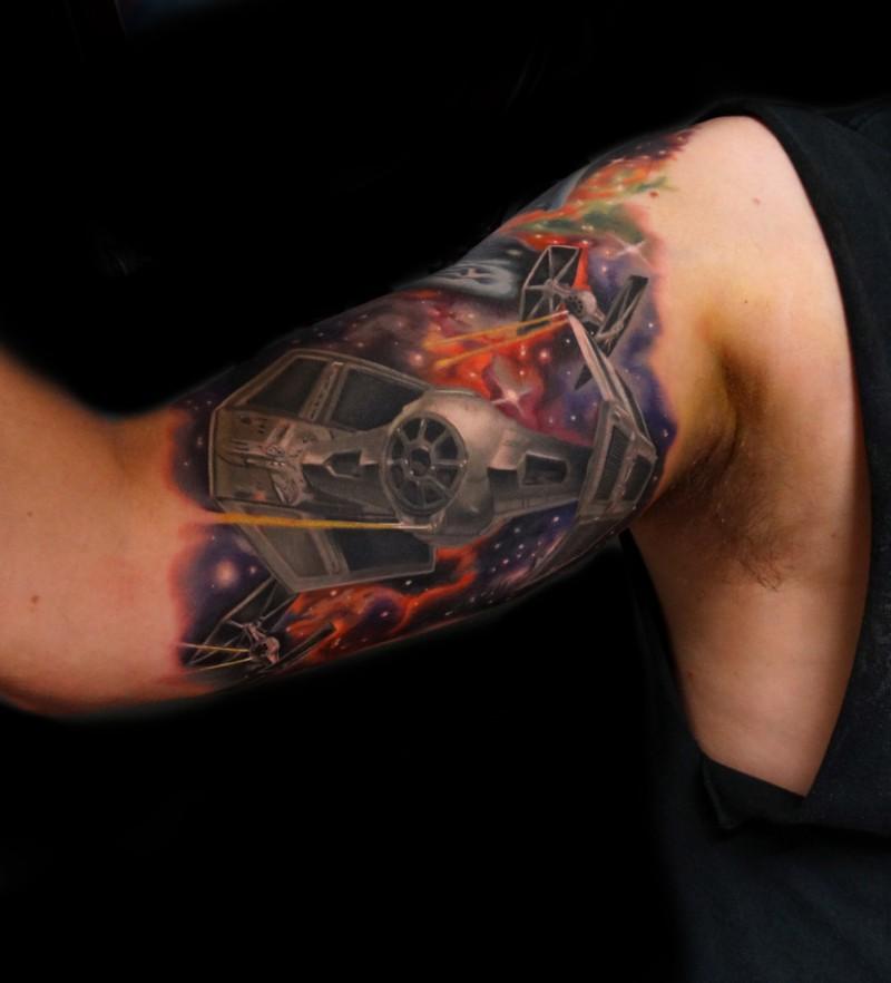 Cool star wars theme tattoo on biceps