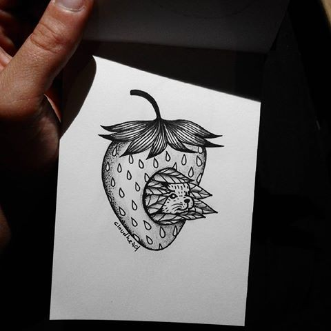 Cool uncolored rodent head looking out of strawberry tattoo design