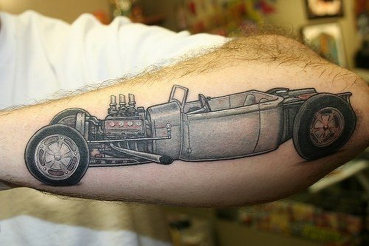 Cool vintage car tattoo on outer forearm