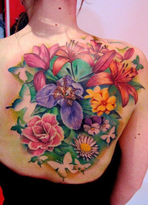 Cool vivid-colored tropical flowers tattoo on back