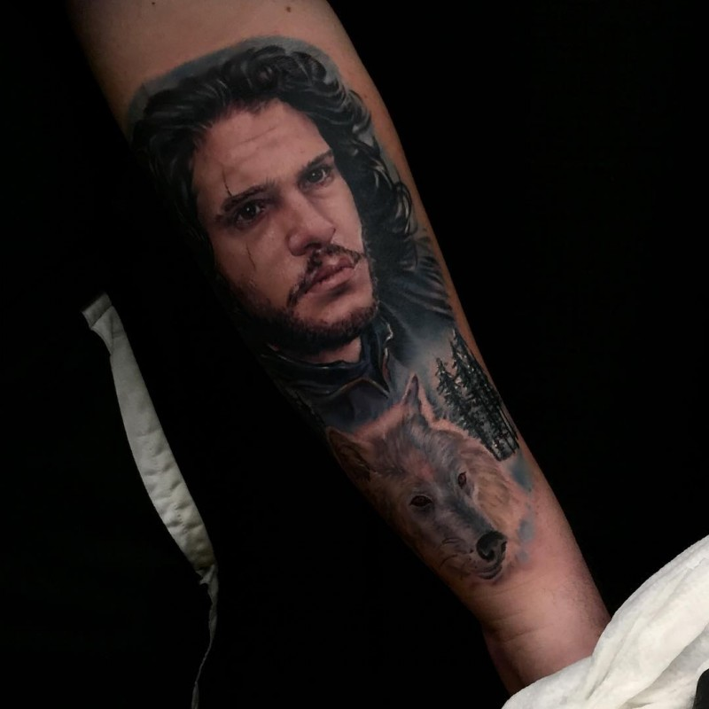 Cool wolf with John Snow tattoo on arm