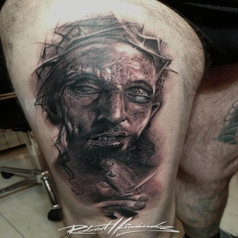 Creepy looking detailed thigh tattoo of JEsus portrait with vine