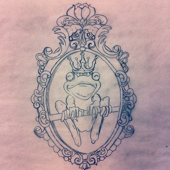 Crowned frog king sitting on branch in mirror frame tattoo design