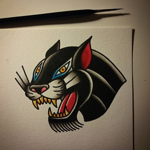 Cunning traditional panther head tattoo design
