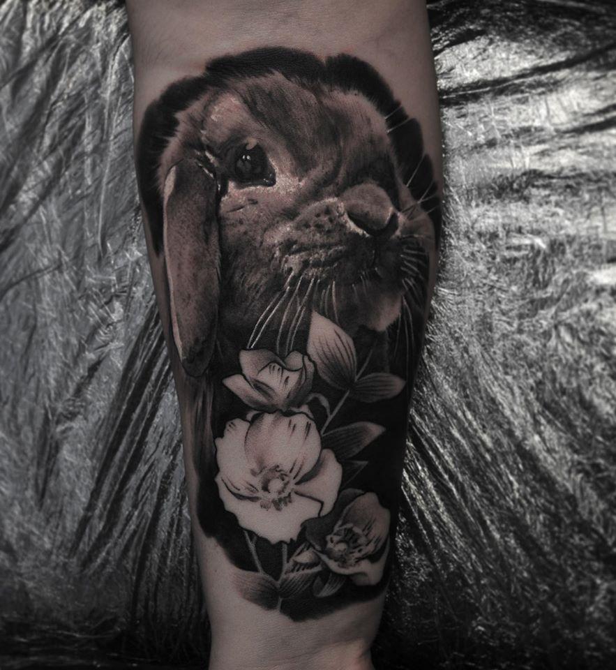 Cut rabbit and flowers tattoo