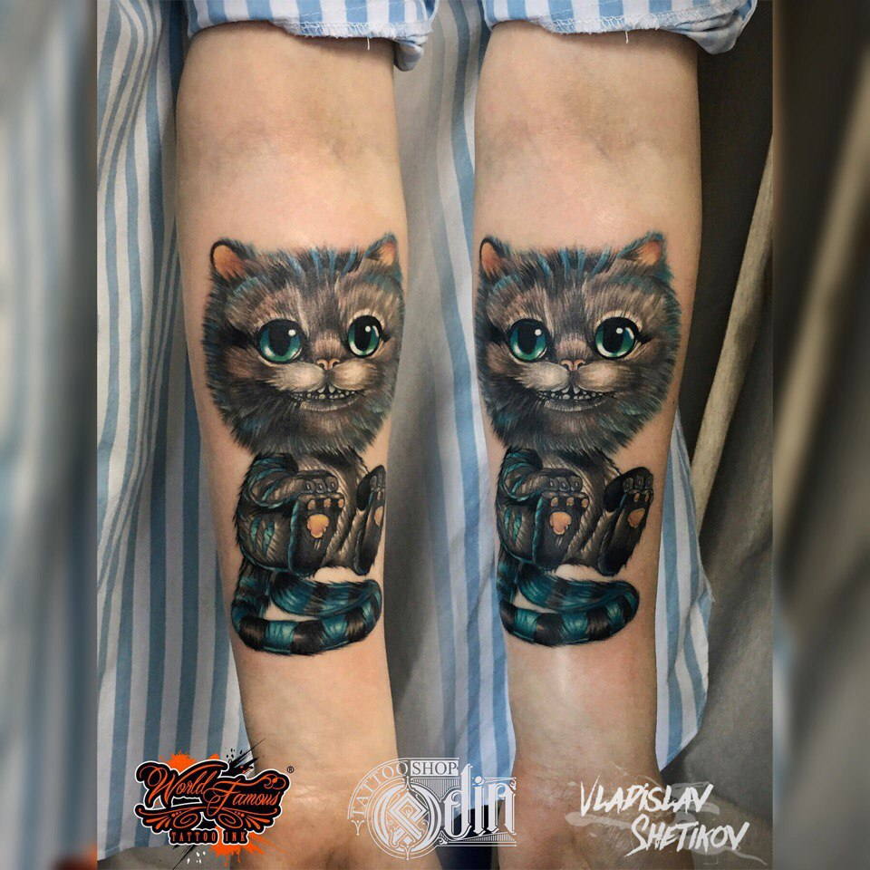 Cute Cheshire Cat tattoo on forearm